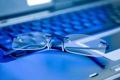 Business glasses on a laptop keyboard Stock Images
