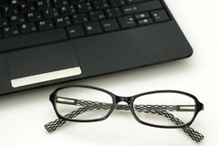 Business glasses near a laptop keyboard Stock Photo