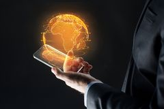 Hand with smartphone and earth hologram. Business, globalization and future technology concept - close up of businessman hand with transparent smartphone and Royalty Free Stock Photo