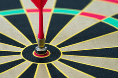 Business goal or target concept with a magnetic red dart in the Stock Images