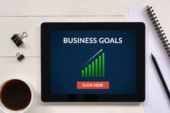 Business goals concept on tablet screen with office objects Royalty Free Stock Photography
