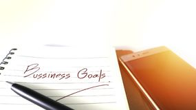Business Goals wording Concept and Mobile on Blurred Isolate Ba stock images
