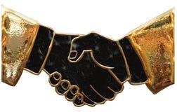 Business gold handshake Stock Photo