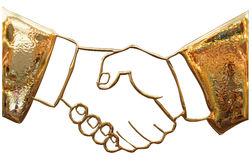 Business gold handshake Royalty Free Stock Photo