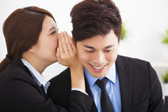 Business gossip between business woman and man Stock Photos