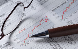 Business graph. With spectacles and pen Stock Image