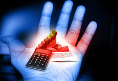 Business graph and calculator. In human hand Stock Images