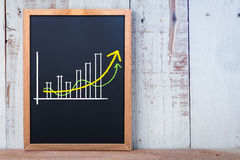 Business graph on chalkboard.jpg Royalty Free Stock Photo