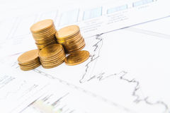 Business graph with coins Royalty Free Stock Images