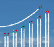 Business Graph Concept. Business graph chart diagram concept as a group of acrobatic jet airplanes flying with smoke trails shaped as a financial infograph icon Stock Image