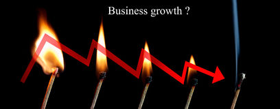 Business graph down. With fire of stick match stock image