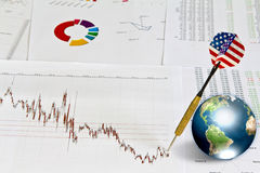 Business graph with earth and dart Stock Images