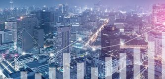 Business graph incresing with city skyscraper background stock image