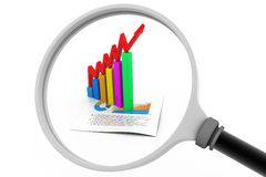Business graph and magnifying glass Stock Photos