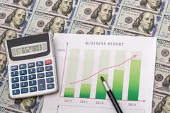 Business graph with money. On desk Royalty Free Stock Image