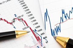 Business graph and a pen Royalty Free Stock Photo