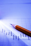 Business graph and pencil in beam of light Stock Photography