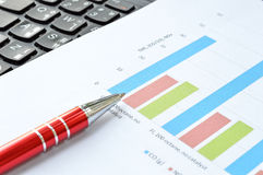 Business graph with red pen. Business graph with red pen Royalty Free Stock Images