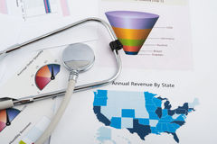 Free Business Graph With Stethoscope Royalty Free Stock Image - 29622646