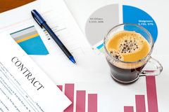 Business graphics and cup of coffee Royalty Free Stock Images