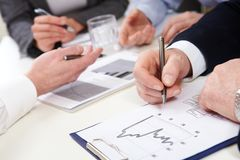 Business graphs. Business people discussing graphs and diagrams stock photos