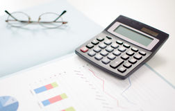 Business graphs with a calculator Stock Photo