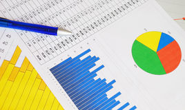 Business graphs and charts. With a blue pen Royalty Free Stock Photography