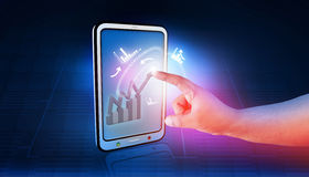 Business graphs and charts. Being demonstrated on the screen of a touch-pad Stock Image