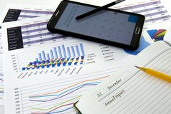 Business graphs and charts report with pen on desk of financial advisor. Financial accountancy Concept. Stock Photo