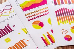 Business graphs and diagrams in yellow and red colours, clouseup.  royalty free stock photos