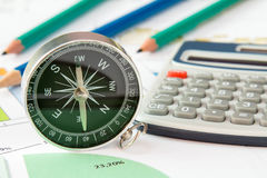 Business graphs and finances with a compass Stock Photography