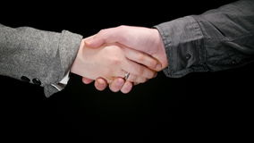Business Greeting Handshake 3. Business greeting, man and woman handshake on a black background 3 stock video footage