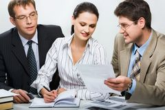 Business group. Confident boss is showing research results to his team in the office Stock Images