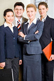 Business group. Portrait of four successful professionals standing in the office Stock Image