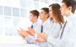 Business group applauding at the office Stock Photos