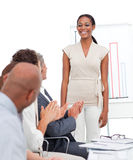 Business group applauding a presentation Stock Photo