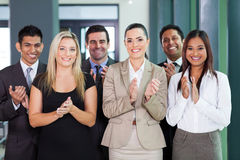 Business group applauding. Smiling business group applauding for good news Stock Images