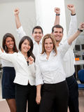 Business group with arms up Royalty Free Stock Images