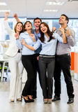 Business group with arms up Stock Image