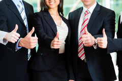 Business - group of businesspeople in office Stock Image