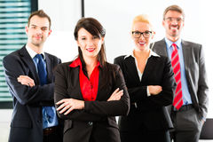 Business - group of businesspeople in office. Business - group of successful and confident businesspeople being a team and showing it stock photography