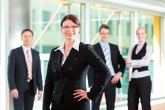 Business - group of businesspeople in office Royalty Free Stock Photos