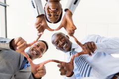 Business group connecting hands. Low angle view of business group connecting hands stock photos