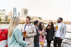 Business group drinking beer after work in London royalty free stock photos
