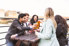 Business group drinking beer after work in London stock photography