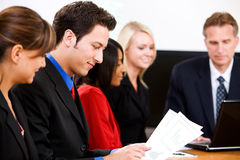 Business: Group Of Employees During Business Meeting Stock Photo