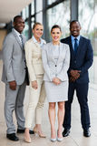 Business group. Full length portrait of business group in office stock images