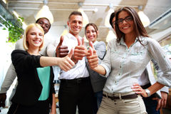 Business group giving thumbs up Stock Image