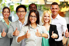 Business group giving thumbs up Stock Images