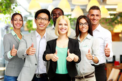 Business group giving thumbs up Royalty Free Stock Images